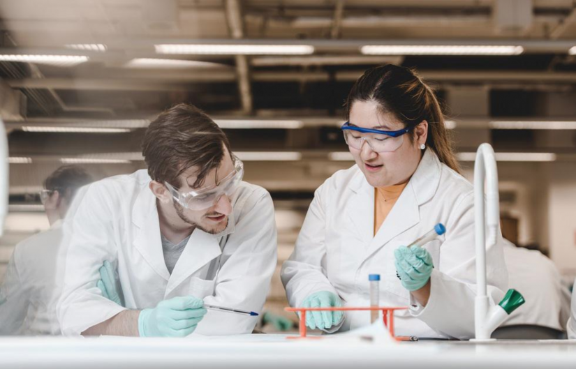 Male and female scientists in the lab