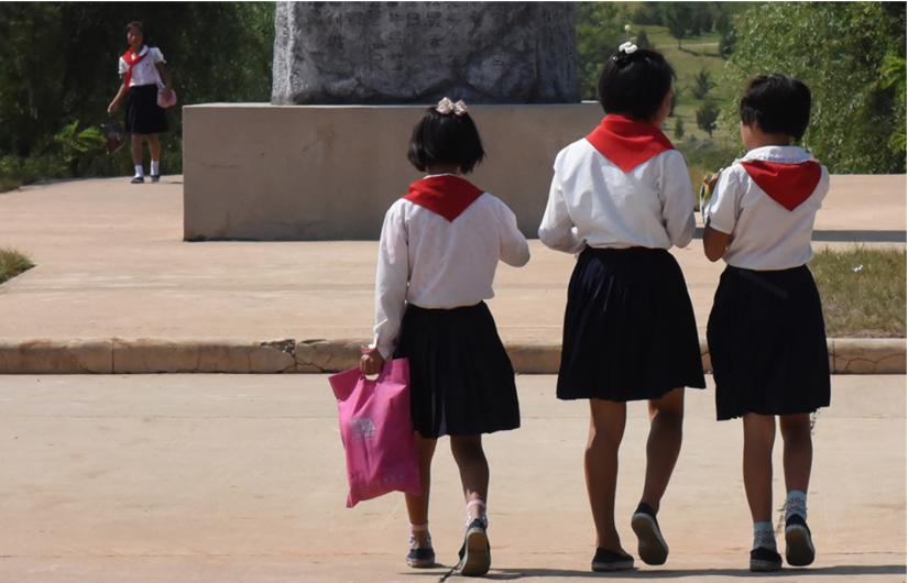 North Korean schoolgirls in Pyongyang facing away