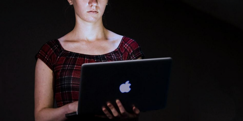 Photo of young girl on laptop in the dark