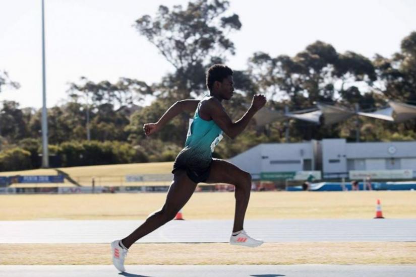 Photograph of triple jumper Emmanuel Fakiye running on the track.