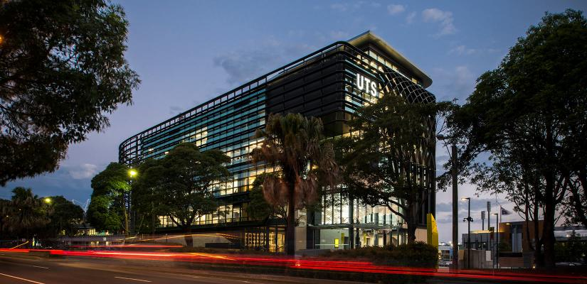UTS Rugby Australia Building illuminated at night