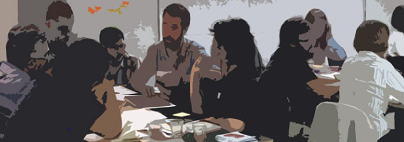 People sitting around a table having a discussion in a work environment