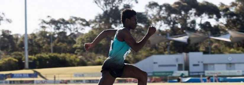 Photograph of triple jumper Emmanuel Fakiye running on the track