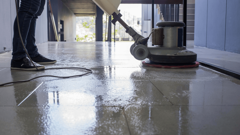 Commercial cleaner cleaning floor