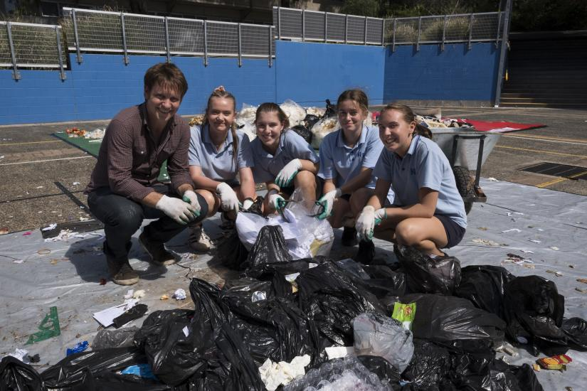 Craig Reucassel with students from Kiama High School doing a waste audit.
