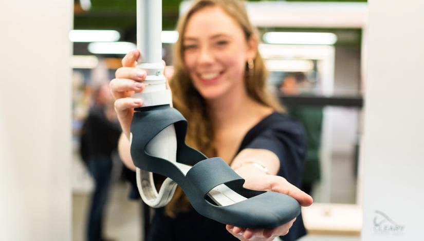 Eloise Cleary holding her prosthetic heel design