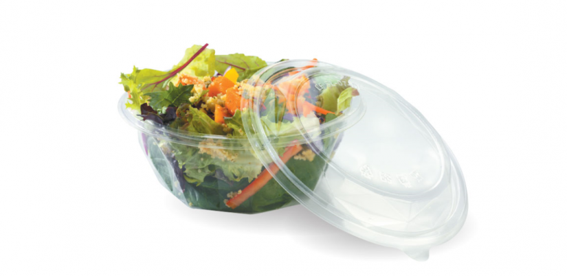 A PLA container that looks like plastic, holding a salad