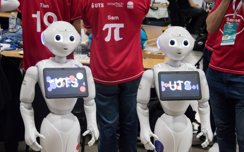 UTS Unleashed! team members with humanoid robots at RoboCup 2019.