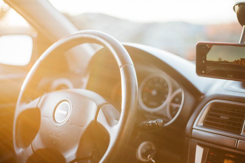 closeup photo of black car steering wheel