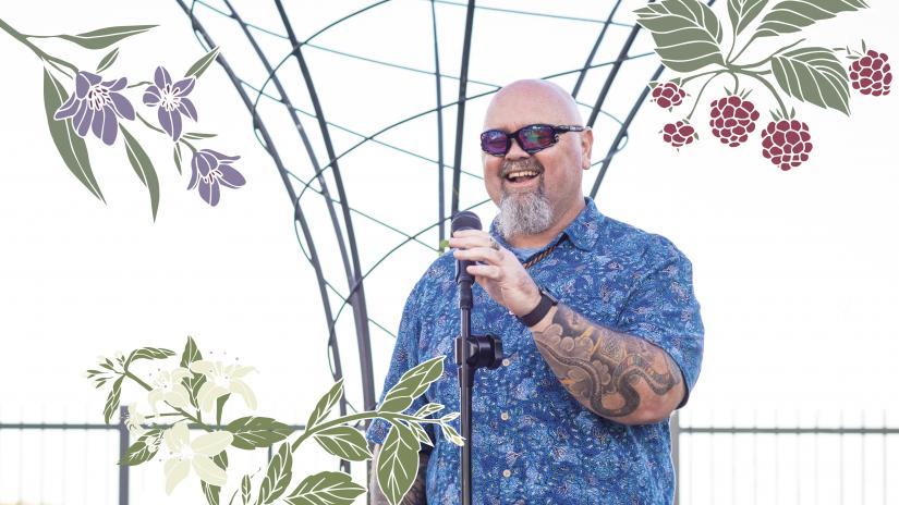 Christian Hampson smiling, standing behind a microphone stand. The photo is overlaid with illustrations of native Australian food plants from the farm.
