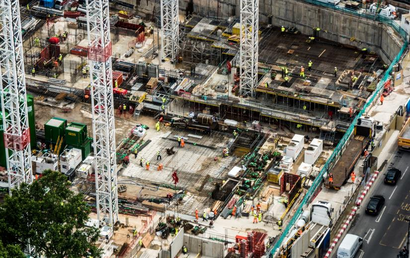 ground-level city building construction site with workers viewed from above