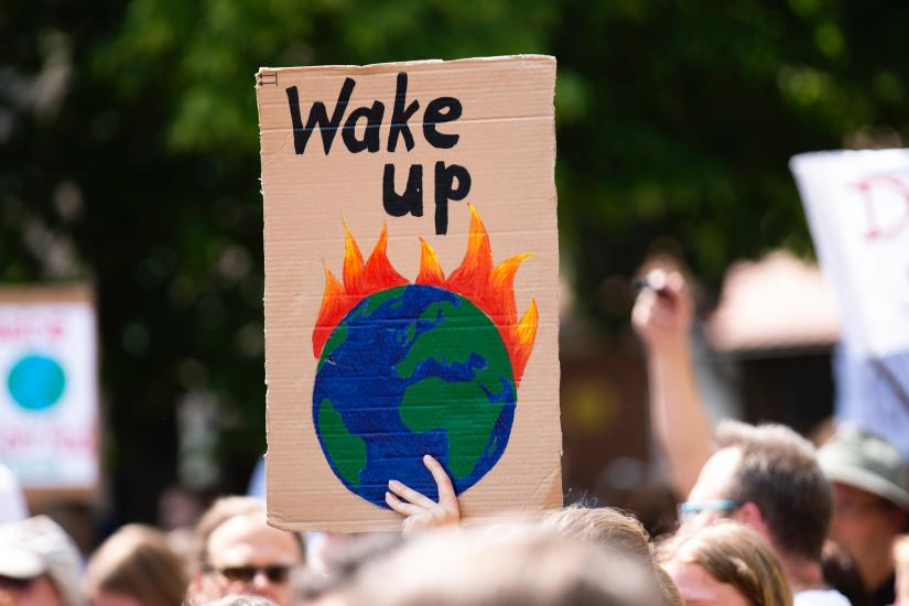 """""""Wake up"""": Placard at a climate change demonstration"""