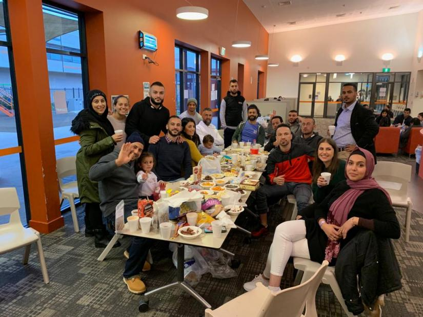 Samira Aili enjoying a group dinner with refugees at Villawood Detention Centre.