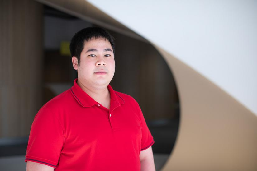 A head shot of UTS Education student Chau Au. He is wearing a red polo shirt.