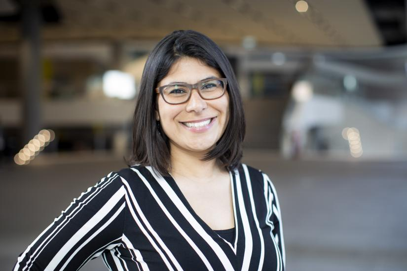 Head shot of UTS Carer-in-Residence Tania Teague. Tania has short black hair, is wearing a black and white striped top and is wearing glasses.