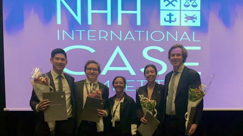UTS Case Team holding awards on stage at NHH International Case Competition