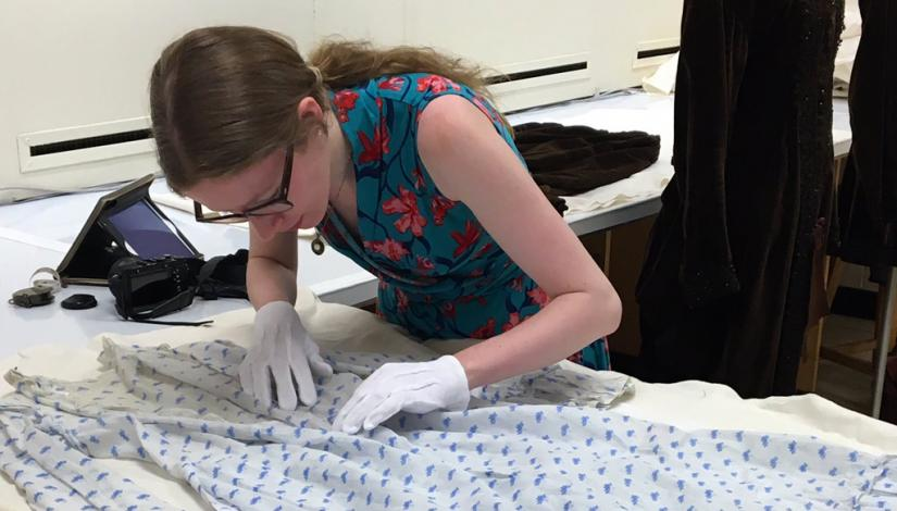 Catriona Fisk examining a potential maternity dress in the Fashion Research Collection at Ryerson University, Toronto, 2016
