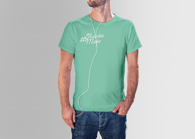 Man wearing a green t-shirt with the thanksmate design mockup