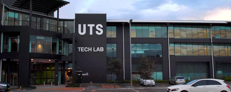 A photo of the UTS Tech Lab building at twilight, with large windows lit up inside