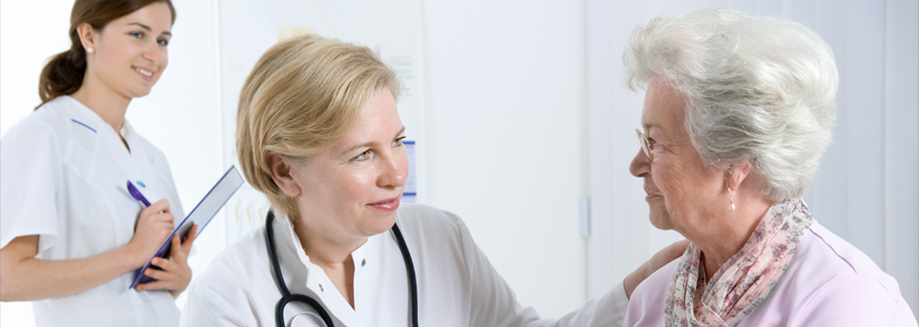 Image of female doctor and pharmacist with elderly patient