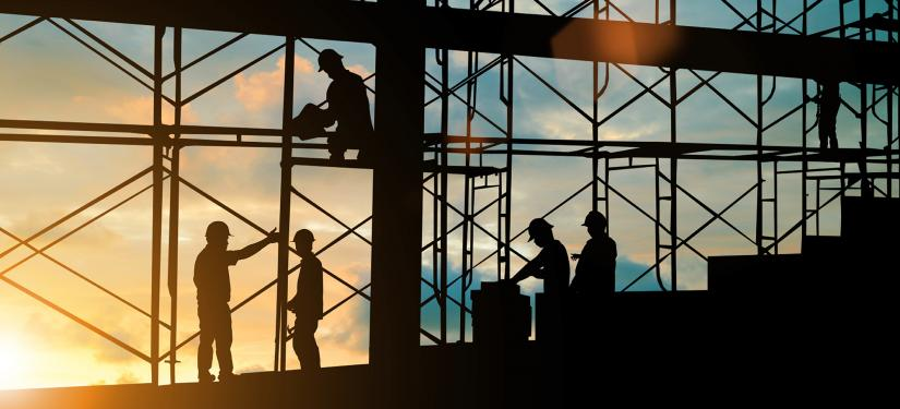 Silhouette of workers on a construction site
