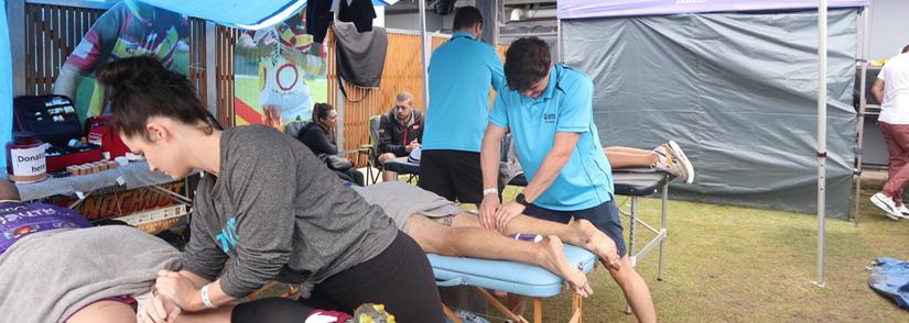 UTS physio students Daisy, David and Jai massaging players