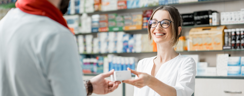 Image of female pharmacist handing medication to patient