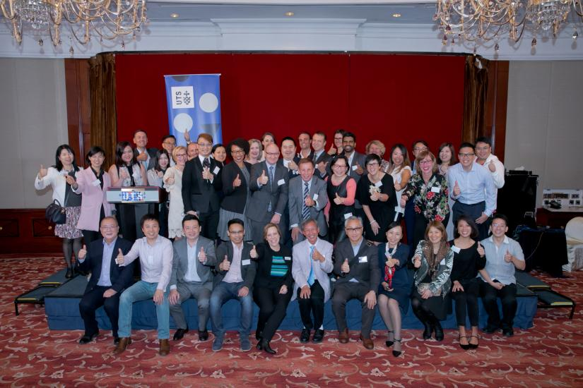 Attendees of the 2018 Hong Kong Alumni reception giving a thumbs up to the camera