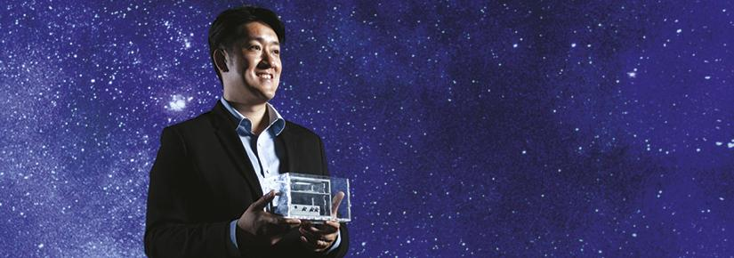 Joshua Chou holding the prototype microgravity device