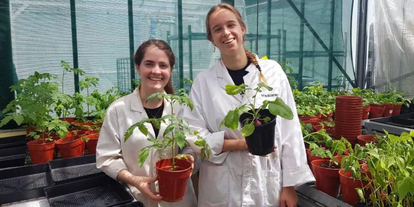 Annaclaire McDonald (L) is researching potential for edible plants to clean up the environment