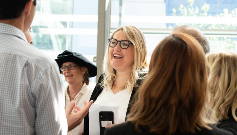 UTS DAB alumna Louise Vlatko mingling with guests following the graduation ceremony