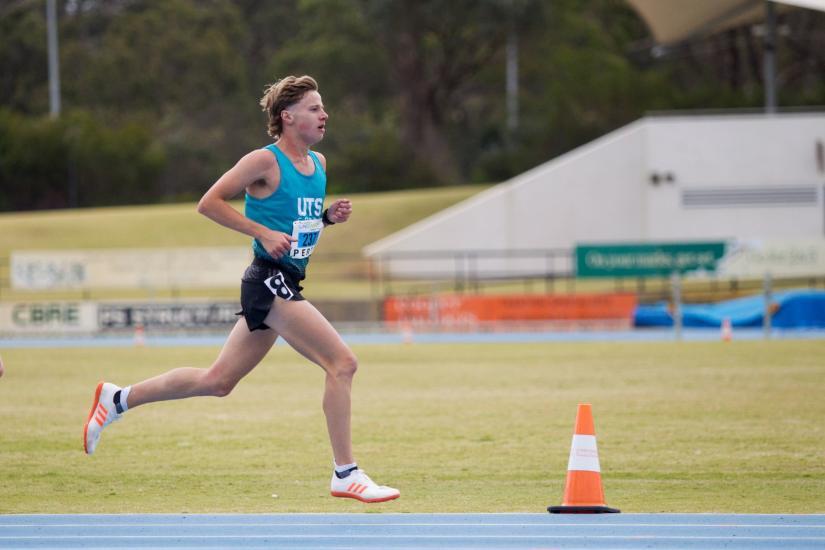 Ed Goddard running in a UTS singlet