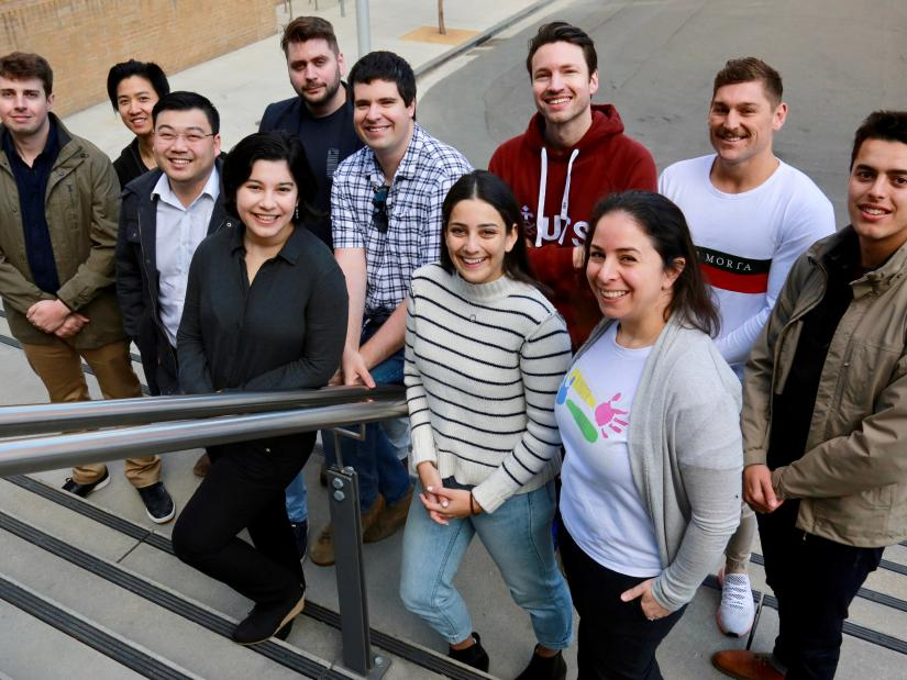 Founders of UTS Startups standing on the stairs smiling at the camera