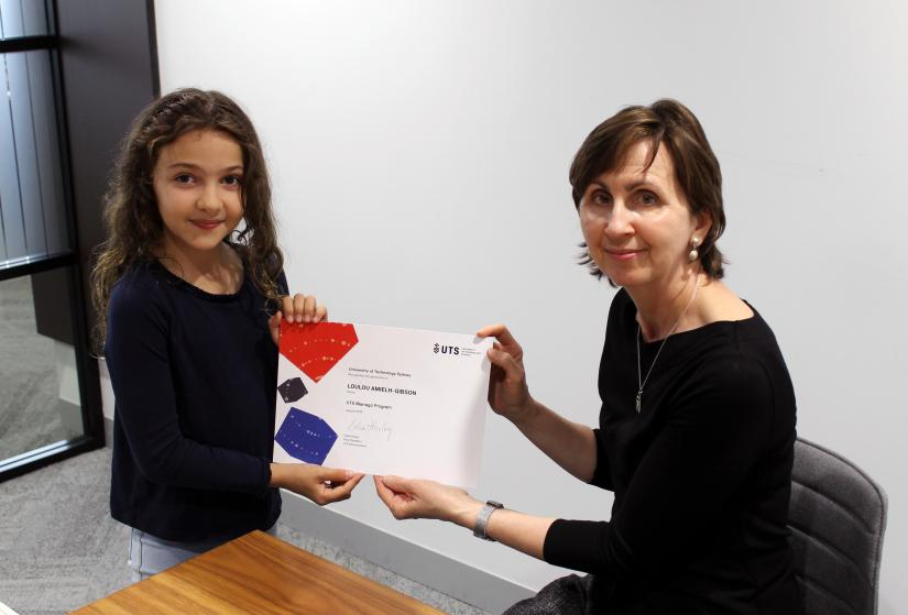 Vice-President of UTS Advancement Celia Hurley presenting a certificate to Loulou Amielh-Gibson
