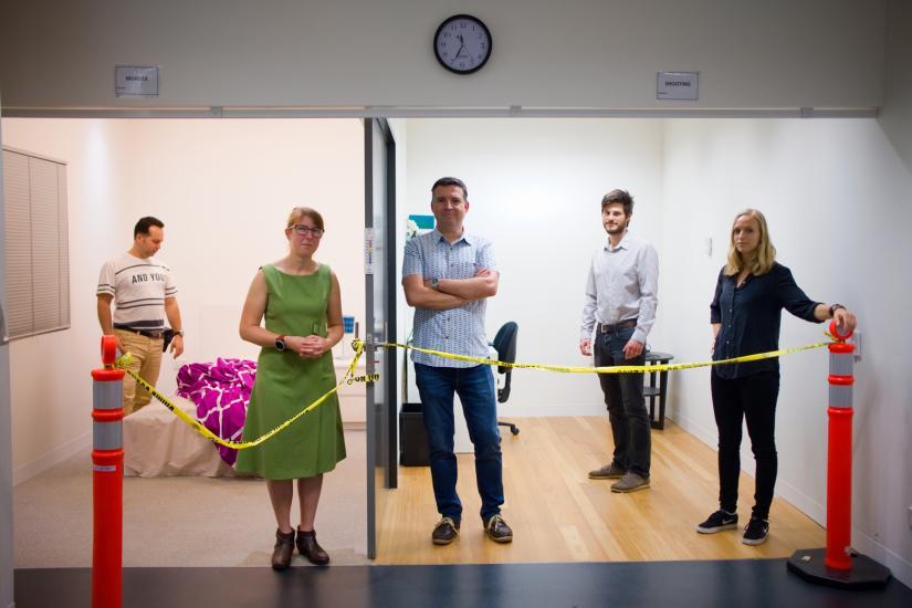 Dr Mark Barash, Dr Xanthe Spindler, Professor Claude Roux, Dr Sebastian Moret, and Dr Maiken Ueland posing in a fake crime scene
