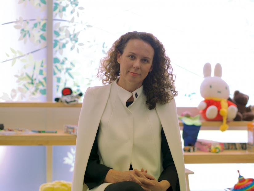 Dr Rachael Murrihy sitting on a chair, facing the camera in front of children's toys in the Kidman Centre