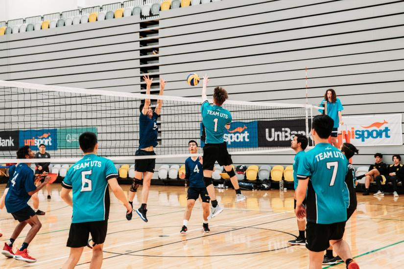 Men's volleyball team playing on an indoor court