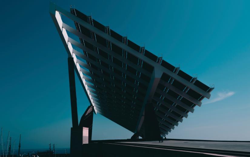 A solar panel array against a sky at dusk