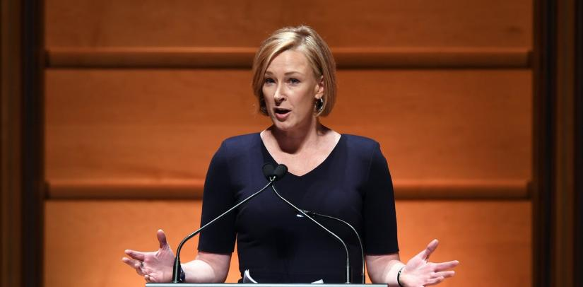 Leigh Sales presenting a speech at a podium