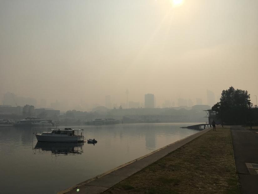 View of boat against smoke haze backdrop