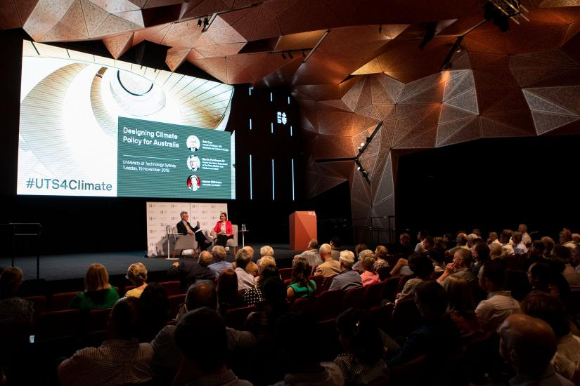 Stage and audience at public event 'Designing Climate Policy for Australia'