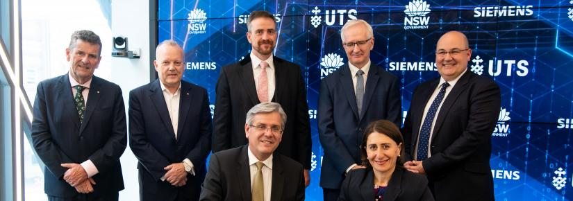 The New South Wales Premier signs an agreement with the Siemens CEO and UTS Vice-Chancellor Attila Brungs.