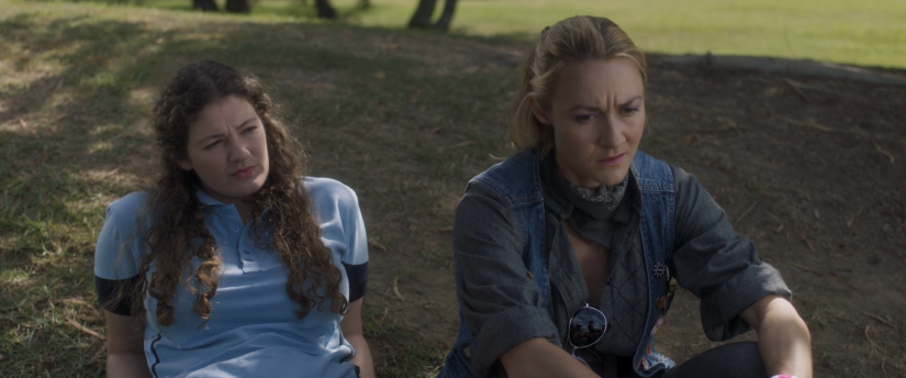 Ellie and Abbie film - promo shot 2 - image of Sophie (as Ellie) sitting on the ground with Julia Billington (as Aunt Tara)