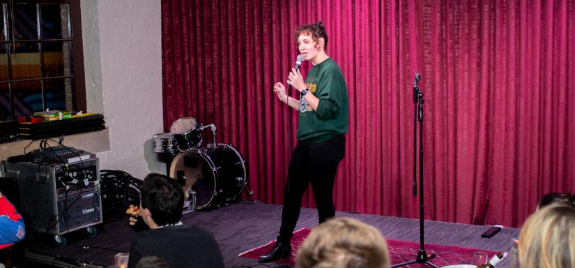 Image of student performing stand-up at The Loft