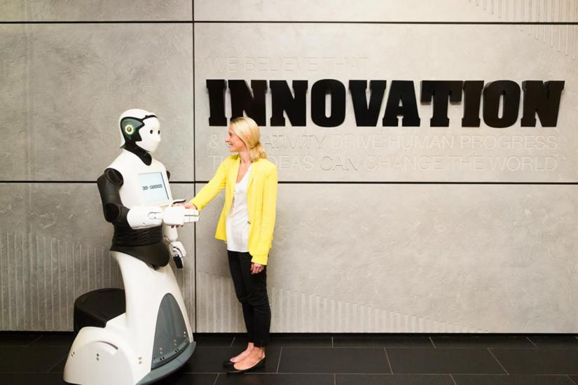 CHIP the humanoid robot shakes hands with a woman