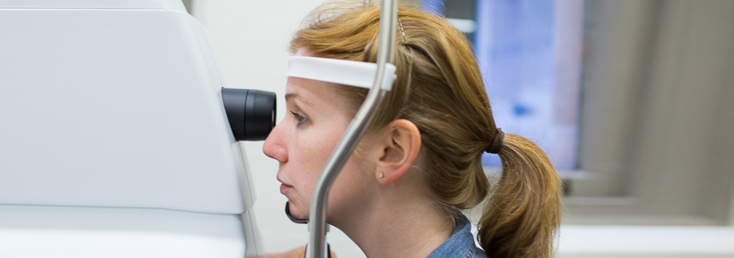 Image of woman undertaking eye test