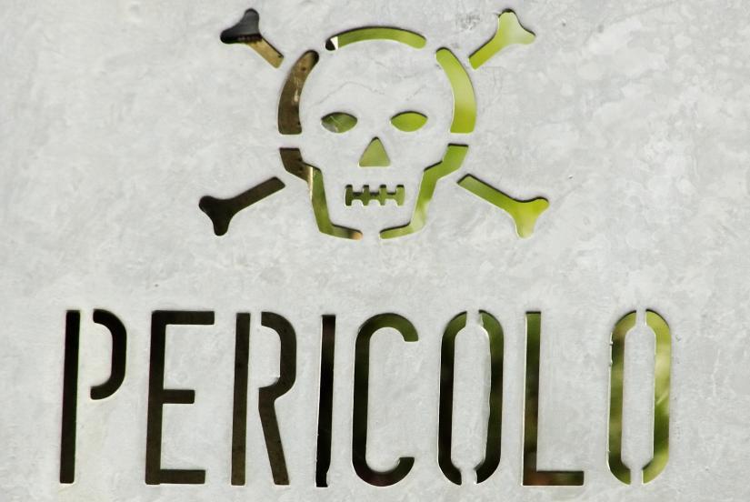 Italian danger sign with skull and crossbones