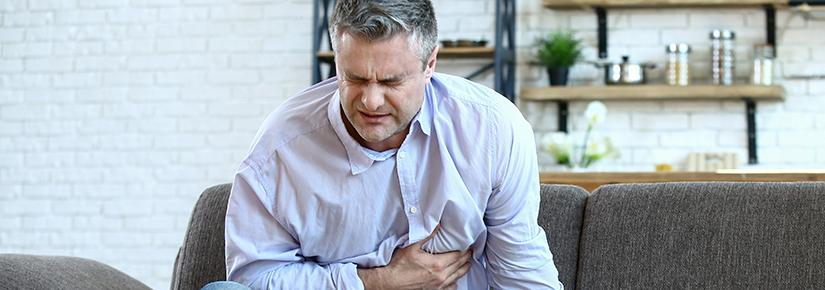 Stock picture of a man clutching his chest in apparent pain