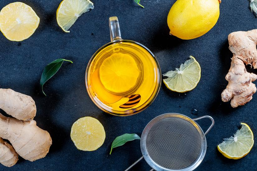 Aerial image of herbal tea surrounded by lemon and ginger