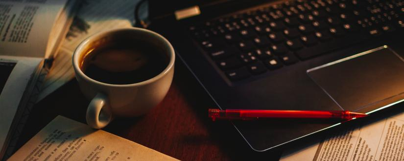Cup of black coffee and a laptop